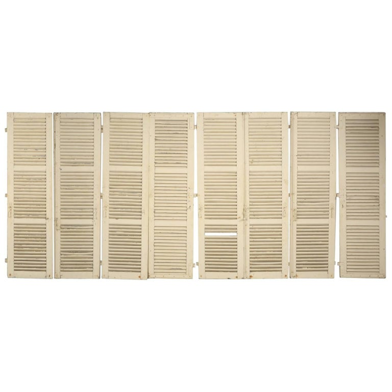 Collection of Eight Antique Painted French Shutters For Sale
