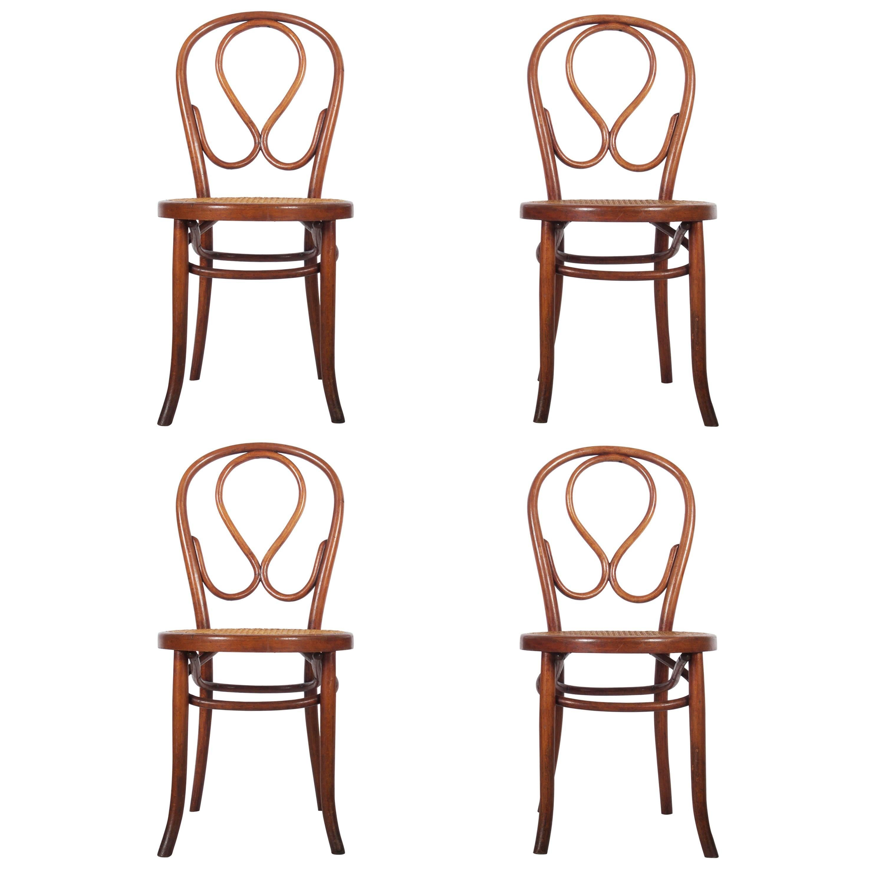 Set Of Four Bentwood Dining Chairs Attributed To Thonet For Sale
