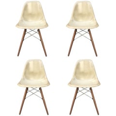 Four Tan Herman Miller Eames Dining Chairs
