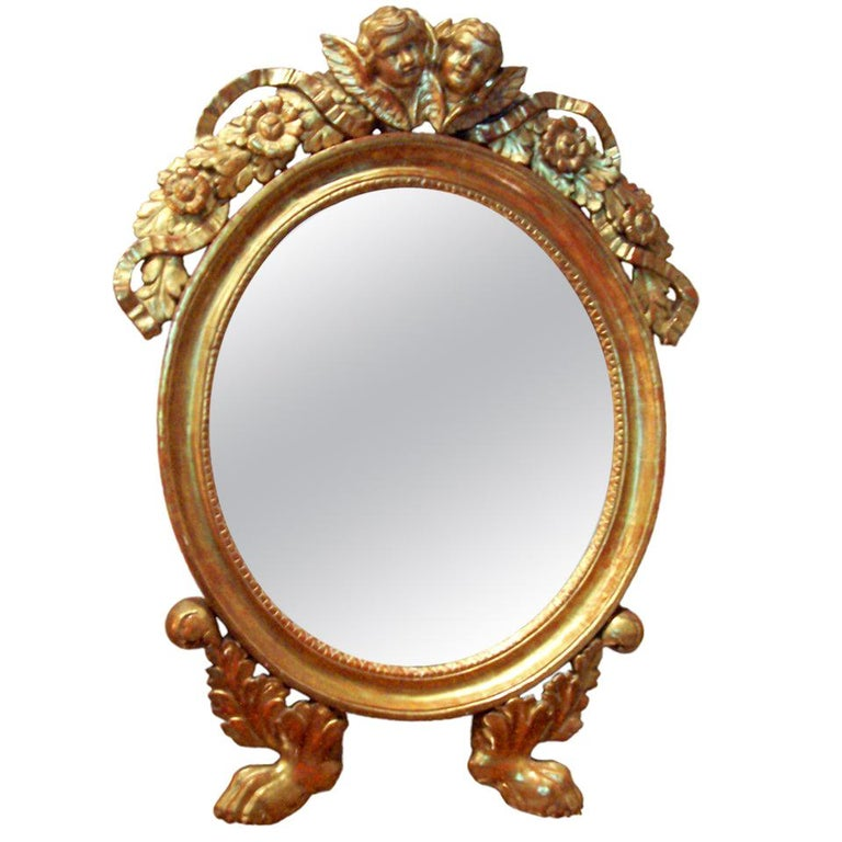 Italian or French Giltwood Mirror with Putti or Cherubs in Lemon Gilt For Sale