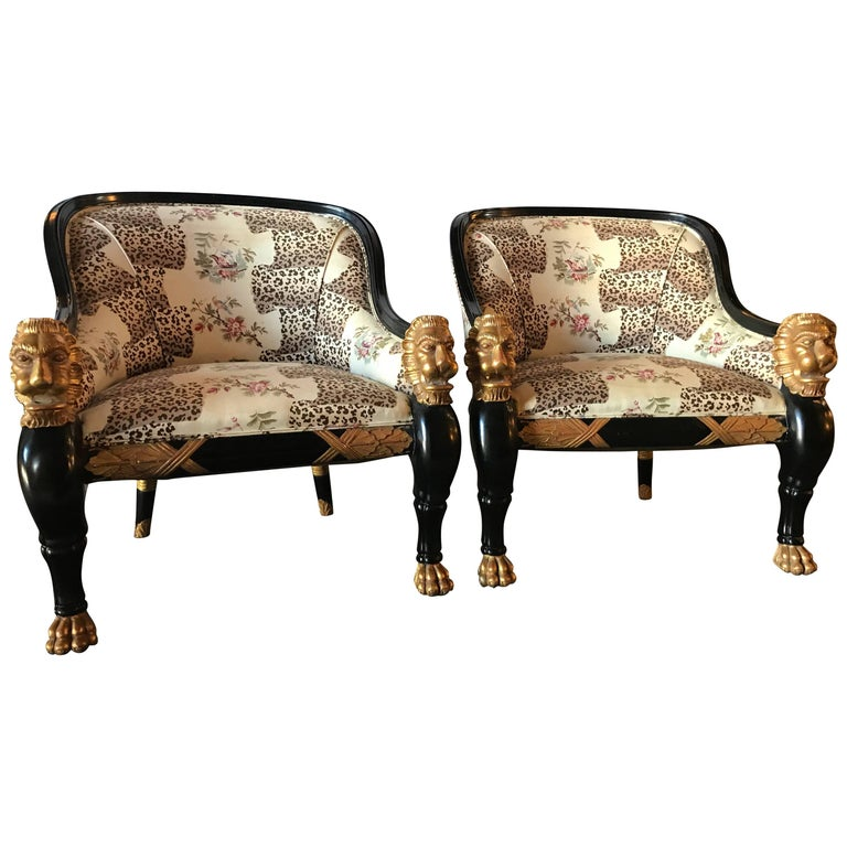 Pair of Lion Head Rest Ebonized Hollywood Regency Armchairs, Maison Jansen