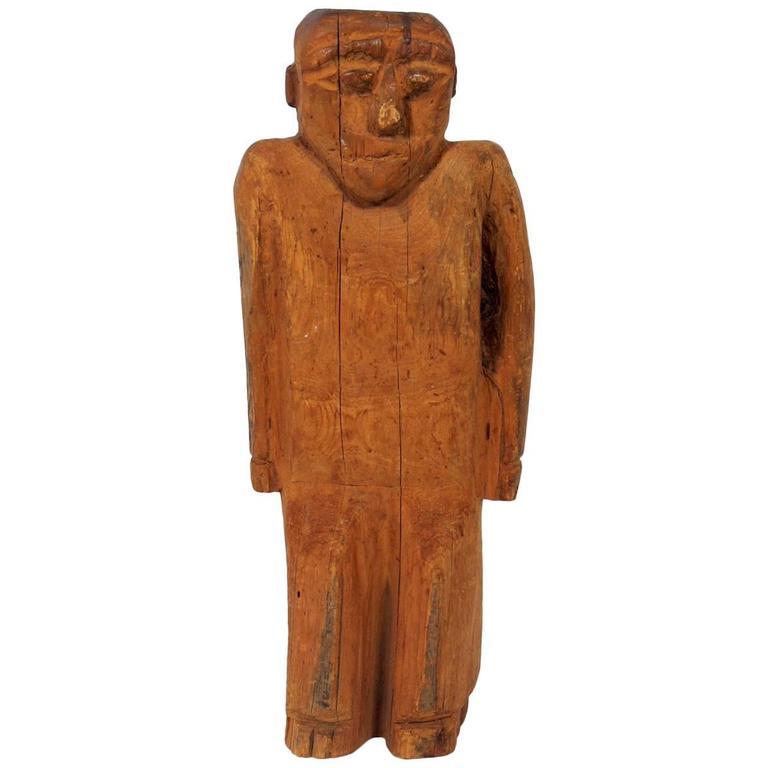 Hand-Carved Folk Art Man Sculpture For Sale