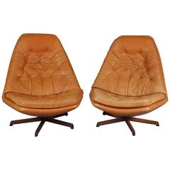 Pair of Swivel Chairs and Ottomans by Madsen & Schubell