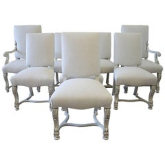 Set of Eight Carved and Linen Upholstered Renaissance Dining Chairs