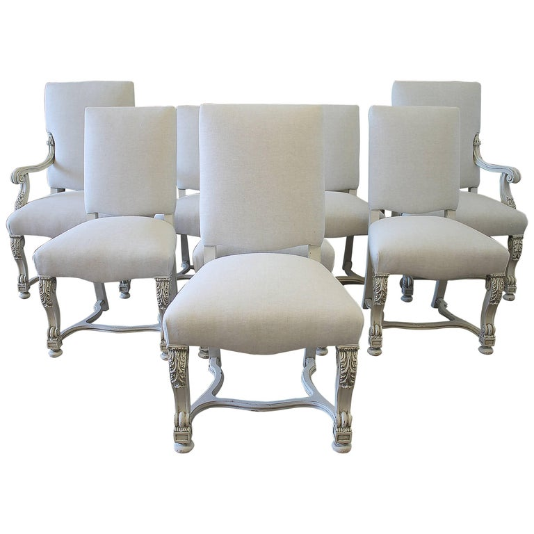 Set of eight carved and linen upholstered renaissance for Upholstered linen dining chairs