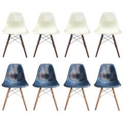 Eight Herman Miller Eames Dining Chairs in Navy and Parchment