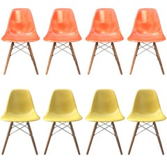 Eight Herman Miller Eames Dining Chairs in Orange and Ochre