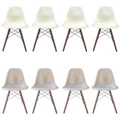 Eight Herman Miller Eames Dining Chairs in Parchment and Tan