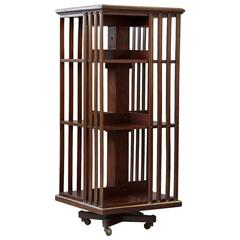 Antique French Revolving Mahogany Bookcase on Raised Casters with Brass Trim