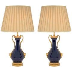 Pair of French Louis XVI Style Cobalt Blue Sèvres Porcelain and Ormolu Lamps