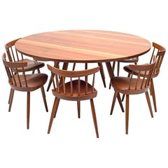 George Nakashima Round Cherry Dining Table and Nine Mira Chairs, USA, 1960s