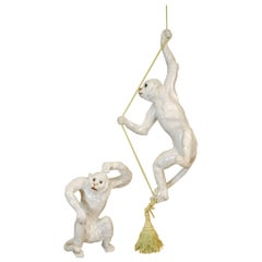 Two 19th Century French Glazed Terracotta Monkeys, One Seated and One Hanging