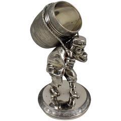 Silver Victorian Era Aesthetic Movement Figural Napkin Ring, Man Toting Barrel
