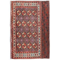 Early 20th Century Antique Tekke Rug with Brown Field and Tribal Motifs in Red