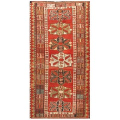 Red Background Antique Kazak Runner with Seven Medallions and Tribal Design