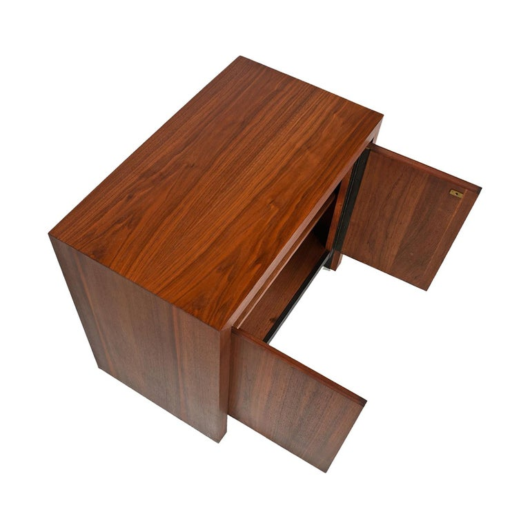 Mid-Century Modern nightstand from Dillingham's Esprit line. One of the most sought after American mid-20th century collections, Esprit's handsome Minimalist style has become a favourite. The sharp black accents a simple yet profound design element