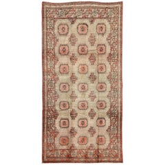 Early 20th Century Antique Khotan Rug with All-Over Geometric Blossom Design