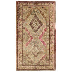 Early 20th Century Antique Khotan Rug with Paired Diamond Medallions in Wine Red