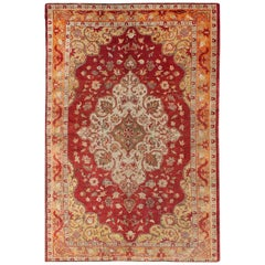 Early 20th Century Antique Turkish Oushak Rug with Floral Medallion and Cornices