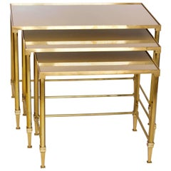 Three Maison Jansen Brass Nesting Tables with Patinated Mirrored Top