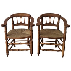 Pair of Spanish Horseshoe Back and Cane Armchairs