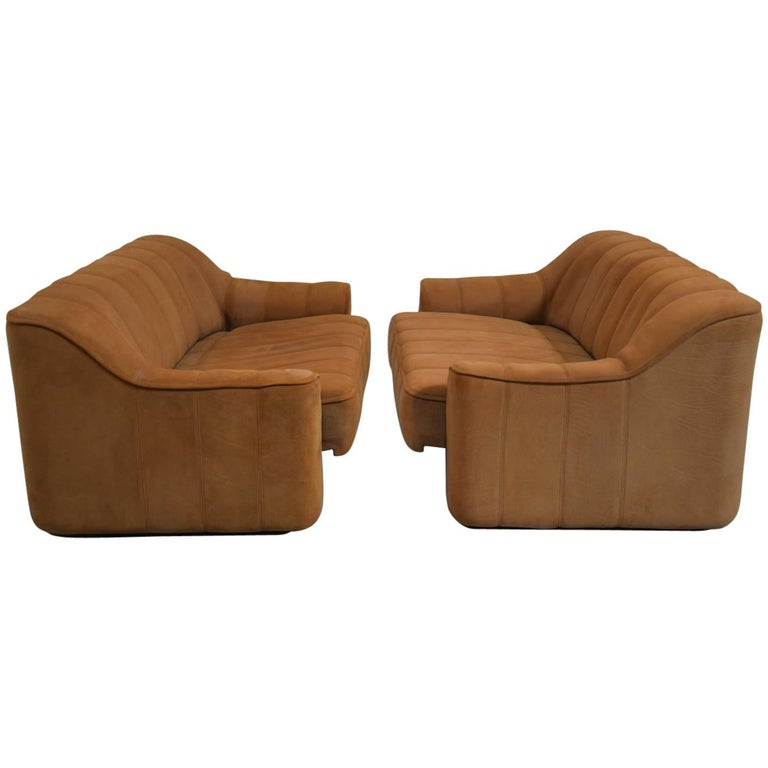 Discounted airfreight for our US and International customers ( from 2 weeks door to door)  We are delighted to bring to you a pair of vintage 1970s De Sede DS 44 two-seater sofas or loveseats in thick buffalo leather with a soft silky texture