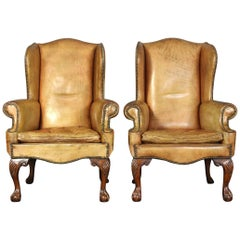 Pair of Vintage Leather Wing Chairs