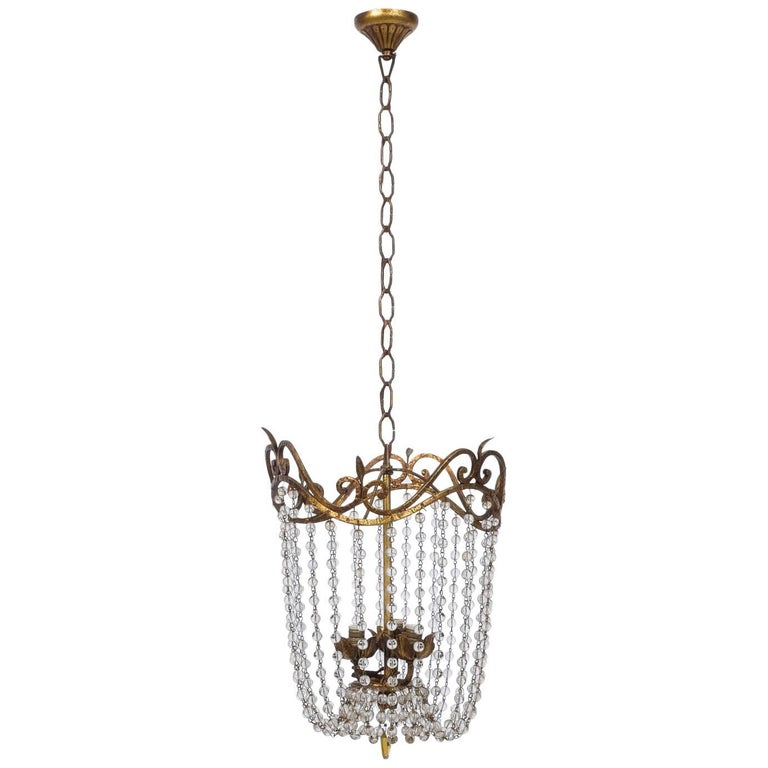 empire chandelier with gilt iron and cascading beads for