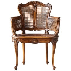Early 20th Century Rococo Style Caned Armchair with Elaborated Carvings
