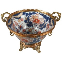 Antique Japanese Imari Hand-Painted Porcelain and Bronze Footed Bowl, circa 1880