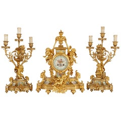 Antique French Gilt Bronze and Sèvres Style Porcelain Three-Piece Clock Set