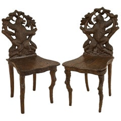Pair of Rustic Black Forest Side Chairs, One Chair containing a Music Box
