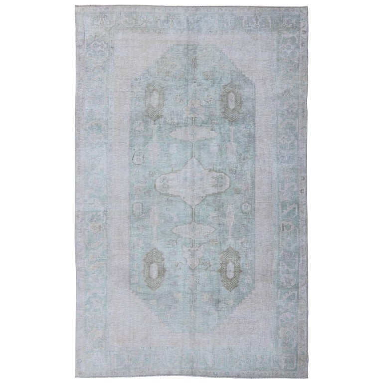 Midcentury Faded Vintage Turkish Oushak Rug With Medallion