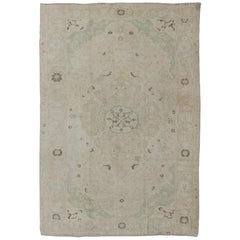 Muted Turkish Oushak Rug with Medallion in Shades of Gray, Ivory and Light Brown
