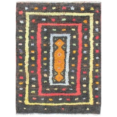 Vintage Turkish Tulu Rug with Tribal Pattern in Black, Yellow, Red, Blue and Red