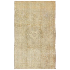Faded Vintage Turkish Konya Rug with Medallion, Florals and Taupe Background