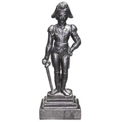 American Cast Iron Napoleon Doorstop Standing on a Step Back Plinth, Circa 1870