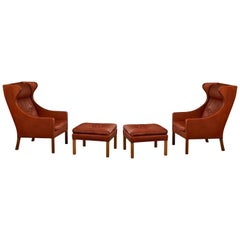 Pair of Børge Mogensen Wing Chairs with Ottomans