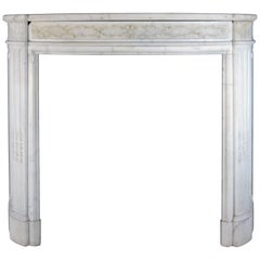 Statuary Marble Bow Fronted Louis XVI Style Mantel with Fluted Jambs