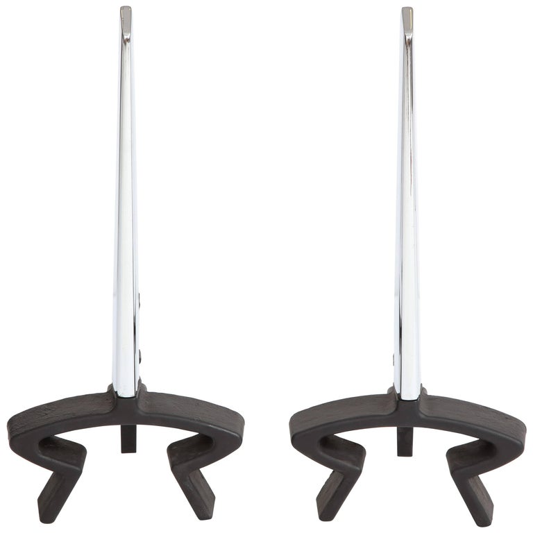 Donald Deskey Andirons Chrome Bennett Signed. Nickel-plated brass tapered blades with newly restored matte black wrought iron shanks. This iconic Deskey design was inspired by the Trylon sphere exhibited at 1939 World's Fair.  Both wrought iron