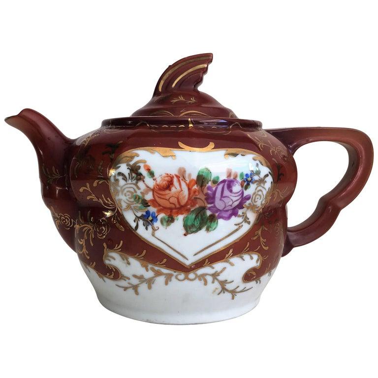Plum Red-Ground Saltglaze Stoneware Teapot and Cover, circa 1940 For Sale