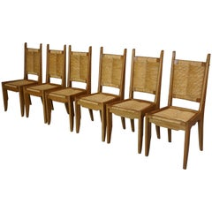 Set of Six Oak Wooden And Braided Straw Chairs Guillerme & Chambron