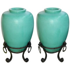 Large Pair of Pottery Urns on Wrought Iron Stands