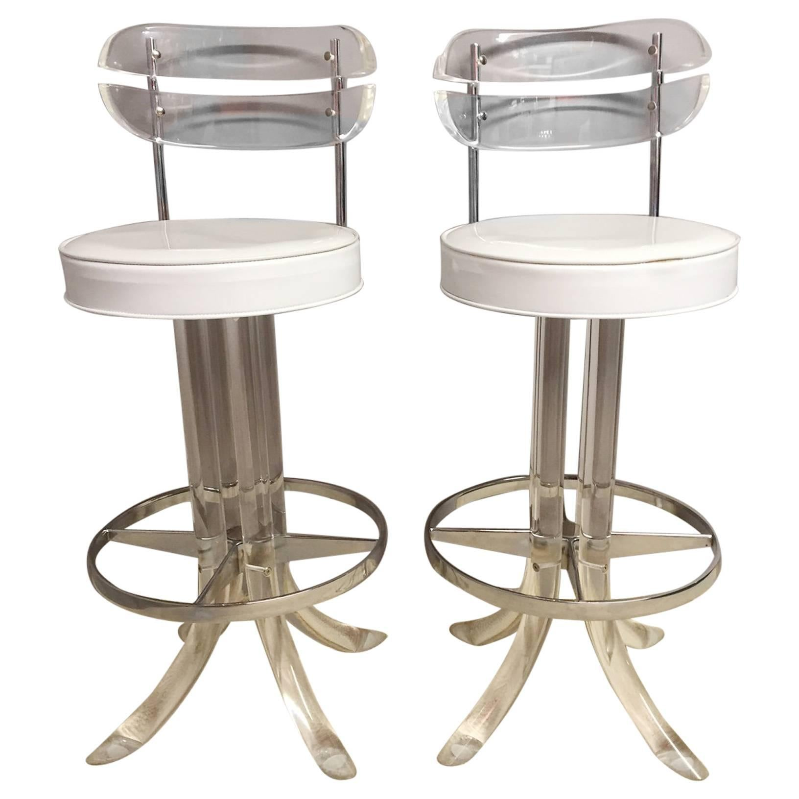 glamorous pair of lucite chrome and patent leather bar stools