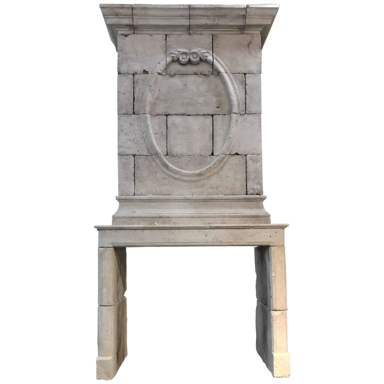 18th Century Limestone Mantel with Hand-Carved Trumeau 1
