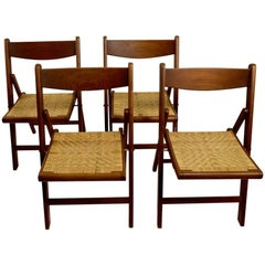 Set of Four Danish Modern Folding Chairs of Solid Teak and Cane