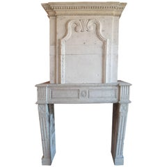 18th Century Louis XVI Stone Fireplace with Trumeau and Geometric Design, France
