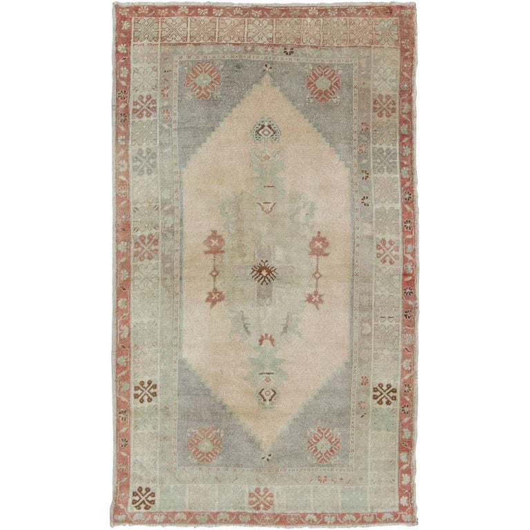 Vintage Turkish Oushak Rug With Tribal Motifs In Faint Red