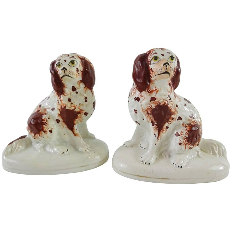 Rare Pair of Seated Red Staffordshire Spaniels on Oval Pedestal Bases 1