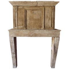 17th Century Louis XIII Stone Fireplace with Hand-Sculpted Trumeau, Provence